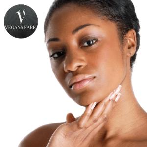 black owned vegan skincare brands, black woman short hair long finfernails touching face and skin