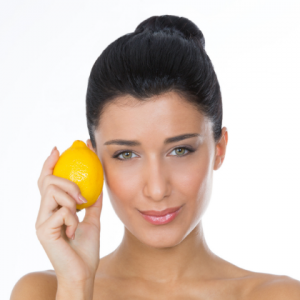 woman holding a lemon, vegan beauty and skincare products,